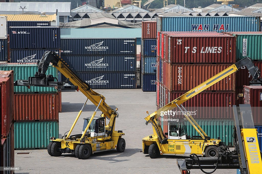 Kalmar reachstackers operate at the Port of Bangkok, Thailand, on Monday, Aug. 25, 2014. Thailand's trade figures are scheduled for release on Aug. 27. Photographer: Dario Pignatelli/Bloomberg via Getty Images