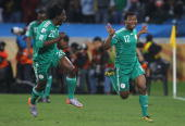 Kalu Uche of Nigeria celebrates with team mate Dickson Etuhu after scoring the opening goal during the 2010 FIFA World Cup South Africa Group B match...