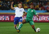 Kalu Uche of Nigeria scores the opening goal under pressure from Cha DuRi of South Korea during the 2010 FIFA World Cup South Africa Group B match...