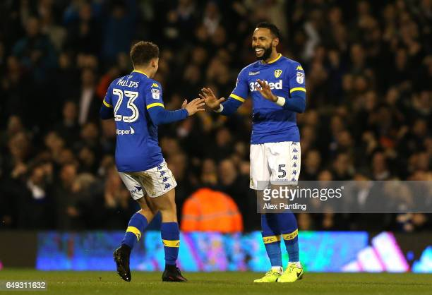 Kalvin Phillips of Leeds United and Kyle Bartley of Leeds United celebrate after Tim Ream of Fulham scores an own goal during the Sky Bet...