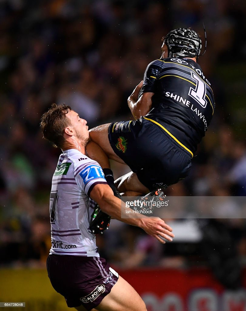 Kalyn Ponga of the Cowboys takes a high ball above Daly Cherry-Evans of the Sea Eagles during the round three NRL match between the North Queensland Cowboys and the Manly Sea Eagles at 1300SMILES Stadium on March 18, 2017 in Townsville, Australia.