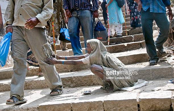 CONTENT] Kalyon India beggar lady grabs onto her victims these are the stairs leading up to the holy shrine Haji Malang outside of MUMBAI