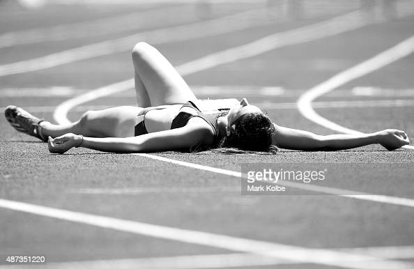 Kalypso Stavrou of Cyprus lies on the track after competing in the girls 400m hurdles during the athletics competition at the Apia Park Sports...
