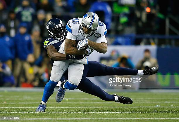 Kam Chancellor of the Seattle Seahawks attempts to tackle Eric Ebron of the Detroit Lions during the first half of the NFC Wild Card game at...