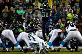 Kam Chancellor of the Seattle Seahawks blocks Graham Gano of the Carolina Panthers but gets called for roughing the kicker in the second quarter...