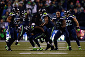 Kam Chancellor of the Seattle Seahawks celebrates after blocking Graham Gano of the Carolina Panthers but gets called for roughing the kicker in the...