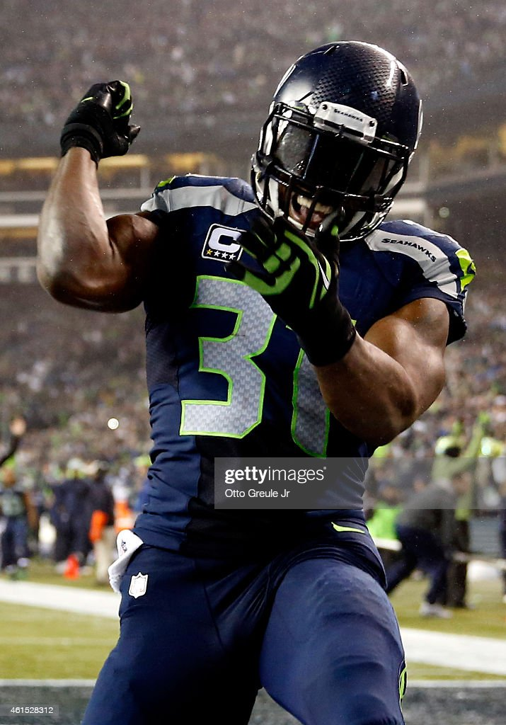 Kam Chancellor #31 of the Seattle Seahawks celebrates after scoring a 90 yard touchdown off of an interception in the fourth quarter thrown by Cam Newton #1 of the Carolina Panthers iduring the 2015 NFC Divisional Playoff game at CenturyLink Field on January 10, 2015 in Seattle, Washington.