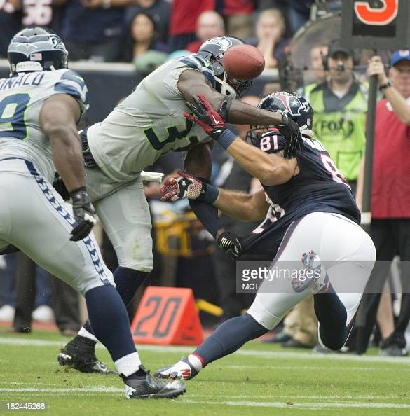 Kam Chancellor of the Seattle Seahawks defends Owen Daniels of the Houston Texans on a pass that was deflected an intercepted in the first half of...