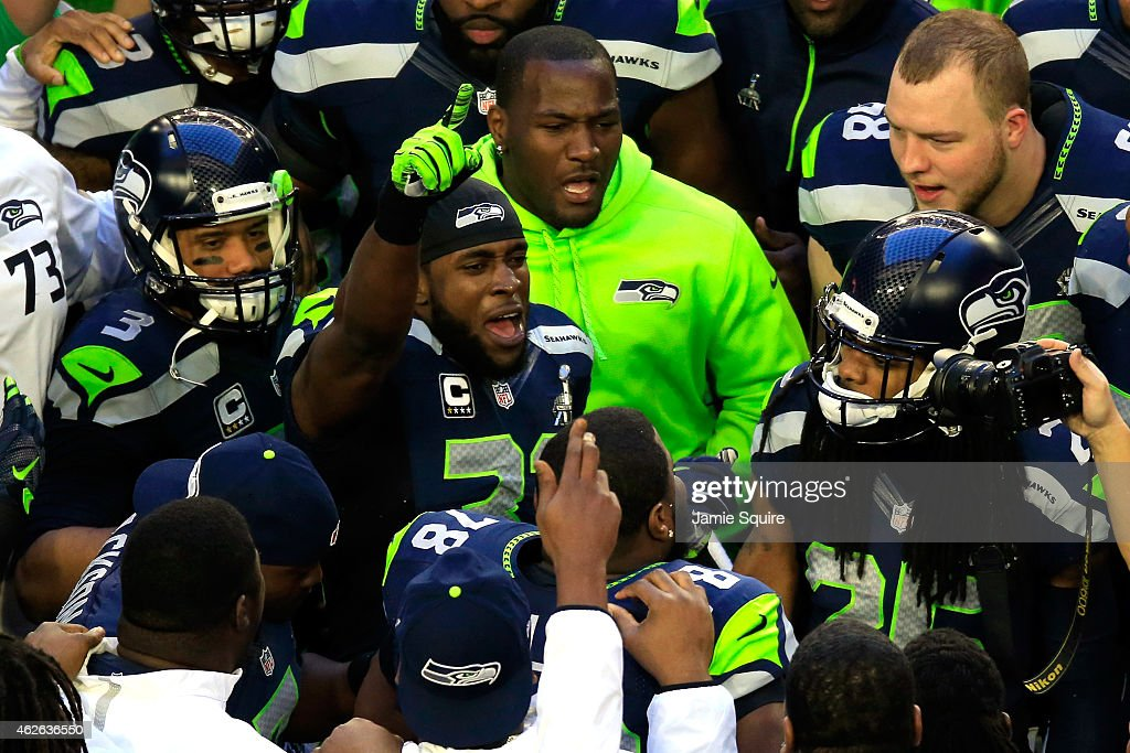 Kam Chancellor of the Seattle Seahawks gets ready with teammates prior to Super Bowl XLIX against the New England Patriots at University of Phoenix...