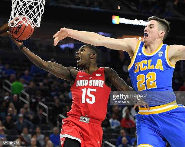 Kam Williams of the Ohio State Buckeyes drives to the basket against TJ Leaf of the UCLA Bruins during the CBS Sports Classic at TMobile Arena on...
