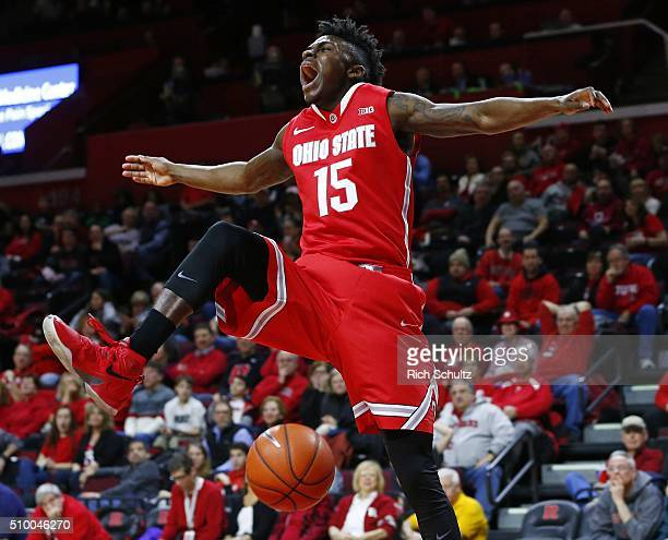 Kam Williams of the Ohio State Buckeyes reacts after a dunk against the Rutgers Scarlet Knights during the first half of a college basketball game at...