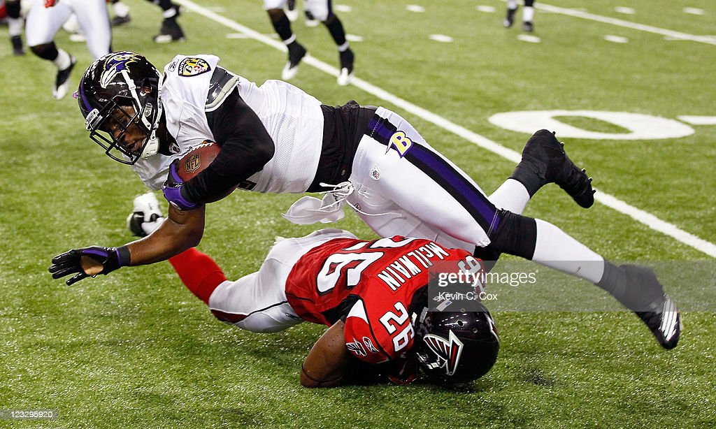 Kamaal McIlwain #26 of the Atlanta Falcons tackles Marcus Smith #11 of the Baltimore Ravens at Georgia Dome on September 1, 2011 in Atlanta, Georgia.