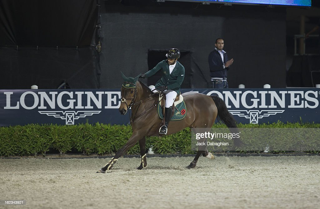 Kamal Bahamdan of Saudi Arabia pets Delphi after completing the track during the President of the UAE Showjumping Cup - Furusyiah Nations Cup Series presented by Longines on February 21, 2013 in Al Ain, United Arab Emirates.