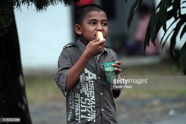 Kamal Hussein 12 years old son of Myanmar Rohingya who live alone enjoyed the bread as an appetizer before dinner in temporary shelters Myanmar and...