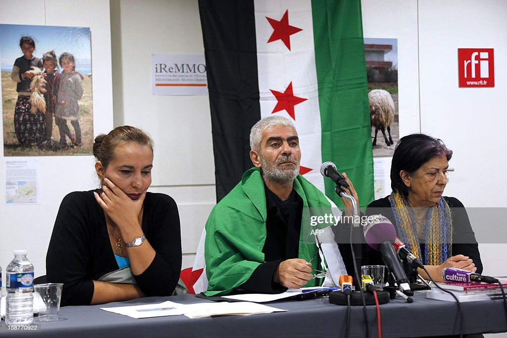 Kamal Jamal Beck (C), former director of programming at the official SANA radio and the SANA online news website in Damascus, speaks during a press conference in Paris, on December 28, 2012, as he and two other colleagues from the radio service, Lama Al-Khadra (L) and Baddour Abdel Karim (R), announce their recent defection from official Syrian state media. The three Syrian journalists said they have now joined ranks with the revolution and stated they left Syria fearing for their lives after planning to quit their jobs in protest at ongoing bloodshed and violence perpetrated by the regime of Syrian president Bachar al-Assad. More than 45,000 people have been killed in Syria since the outbreak in March 2011 of an anti-regime revolt that became a bloody insurgency after a brutal crackdown on dissent, a watchdog said on December 26. AFP PHOTO / PIERRE VERDY