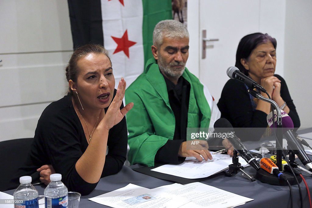 Kamal Jamal Beck (C), former director of programming at the official SANA radio and the SANA online news website in Damascus, listens during a press conference in Paris, on December 28, 2012, as he and two other colleagues from the radio service, Lama Al-Khadra (L) and Baddour Abdel Karim (R), announce their recent defection from official Syrian state media. The three Syrian journalists said they have now joined ranks with the revolution and stated they left Syria fearing for their lives after planning to quit their jobs in protest at ongoing bloodshed and violence perpetrated by the regime of Syrian president Bachar al-Assad. More than 45,000 people have been killed in Syria since the outbreak in March 2011 of an anti-regime revolt that became a bloody insurgency after a brutal crackdown on dissent, a watchdog said on December 26. AFP PHOTO / PIERRE VERDY