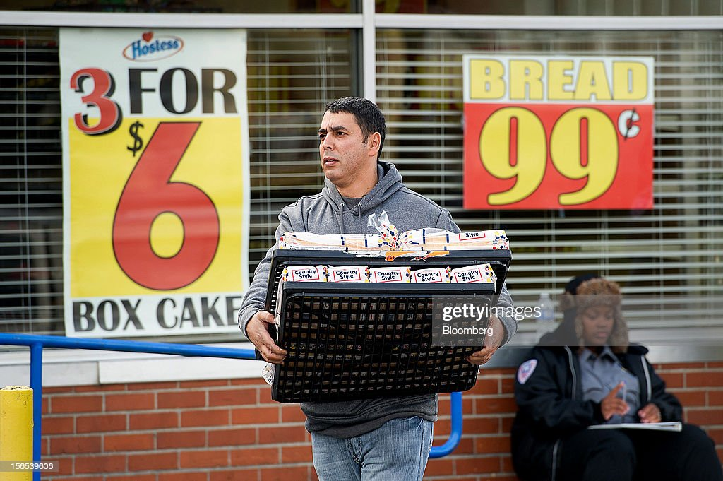 Kamal Moharam walks to his car carrying two racks of Hostess Brands Inc. Wonder Bread at the company's bakery outlet in Sacramento, California, U.S., on Friday, Nov. 16, 2012. Hostess, which also makes Wonder bread, Ding Dongs and Ho Hos, plans to fire more than 18,000 employees and liquidate assets after a nationwide strike by bakery workers crippled operations. Photographer: David Paul Morris/Bloomberg via Getty Images