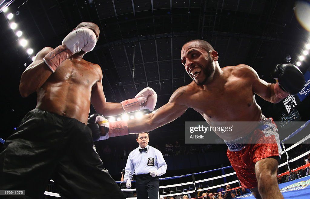 Kamal Muhammad punches Gary Beriguette during their Junior Middleweight fight at Best Buy Theater on August 19, 2013 in New York City.