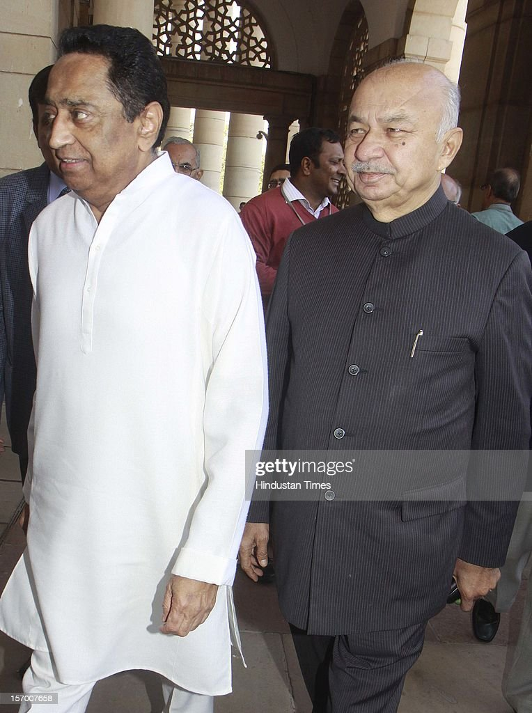 Kamal Nath Minister of Urban Development and Parliamentary Affairs and Home Minister Sushil Kumar Shinde arrive attending all party meeting on to break the deadlock on Foreign Direct Investment issue during the parliament winter session on November 26, 2012 in New Delhi, India. Main opposition party BJP wants debate under rule 184 which has provision of vote but government wants the speaker to decide on debate rules.