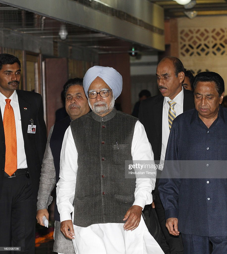 Kamal Nath Union Minister for Parliamentary affairs with Prime Minister Manmohan Singh at a All party meeting called by Loksabha Speaker at Parliament House Library on February 20, 2013 in New Delhi, India. Parliament's budget session beginning on February 21, 2013 is expected to be stormy as chief opposition party BJP has announced that it would disrupt proceedings and take on the UPA government over bribery allegations on the $750-million in VVIP chopper deal. However strucking a conciliatory note Home minister Shinde Regretted his Saffron Terror remark.