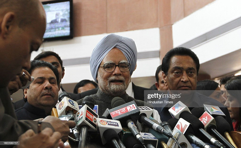 Kamal Nath Union Minister for Parliamentary affairs with Prime Minister Manmohan Singh addressing media after All party meeting called by Loksabha Speaker at Parliament House Library on February 20, 2013 in New Delhi, India. Parliament's budget session beginning on February 21, 2013 is expected to be stormy as chief opposition party BJP has announced that it would disrupt proceedings and take on the UPA government over bribery allegations on the $750-million in VVIP chopper deal. However strucking a conciliatory note Home minister Shinde Regretted his Saffron Terror remark.