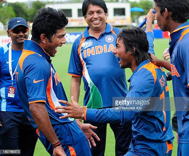 Kamal Passi and Unmukt Chand of India celebrate together after winning the 2012 ICC U19 Cricket World Cup Final between Australia and India at Tony...