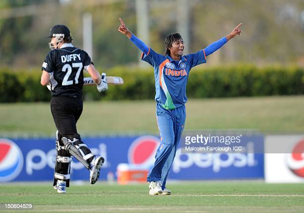 Kamal Passi of India celebrates the run out of Ed Nuttall of New Zealand during the ICC U19 Cricket World Cup 2012 Semi Final match between India and...