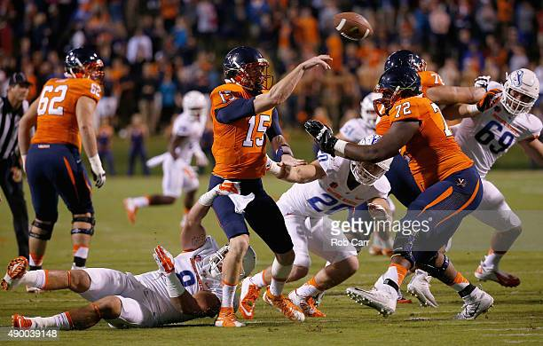 Kamalei Correa of the Boise State Broncos pressures quarterback Matt Johns of the Virginia Cavaliers as he throws an interception that was returned...