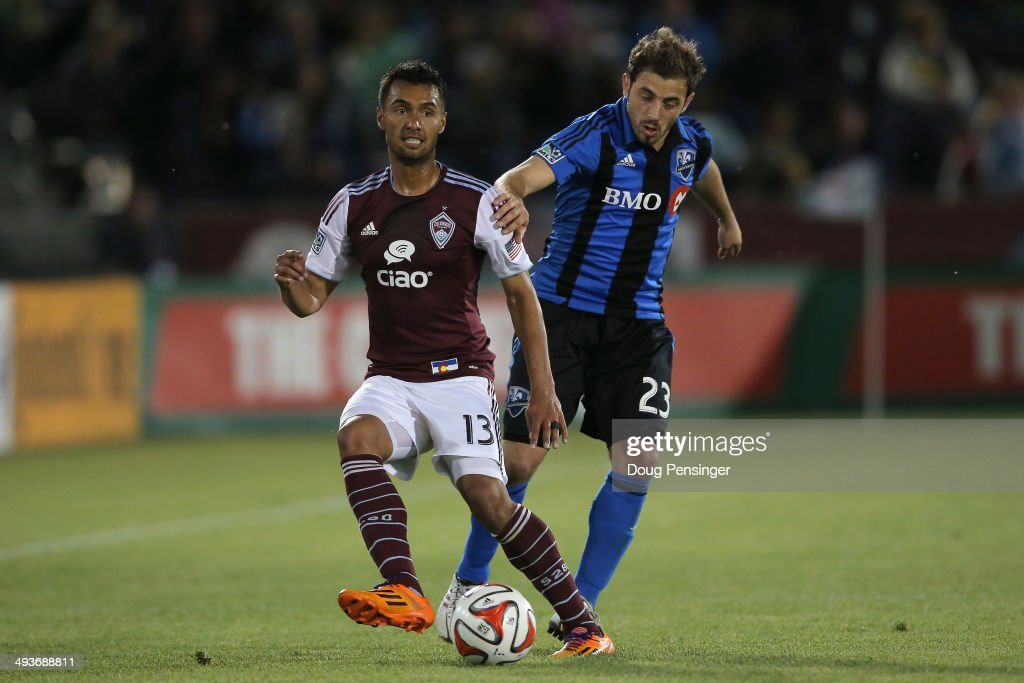 Kamani Hill #13 of the Colorado Rapids controls the ball against Hernan Bernardello #23 of the Montreal Impact at Dick's Sporting Goods Park on May 24, 2014 in Commerce City, Colorado. The Rapids defeated the Impact 4-1.