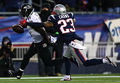 Kamar Aiken of the Baltimore Ravens catches a touchdown pass in the first quarter against Patrick Chung on the New England Patriots during the 2014...