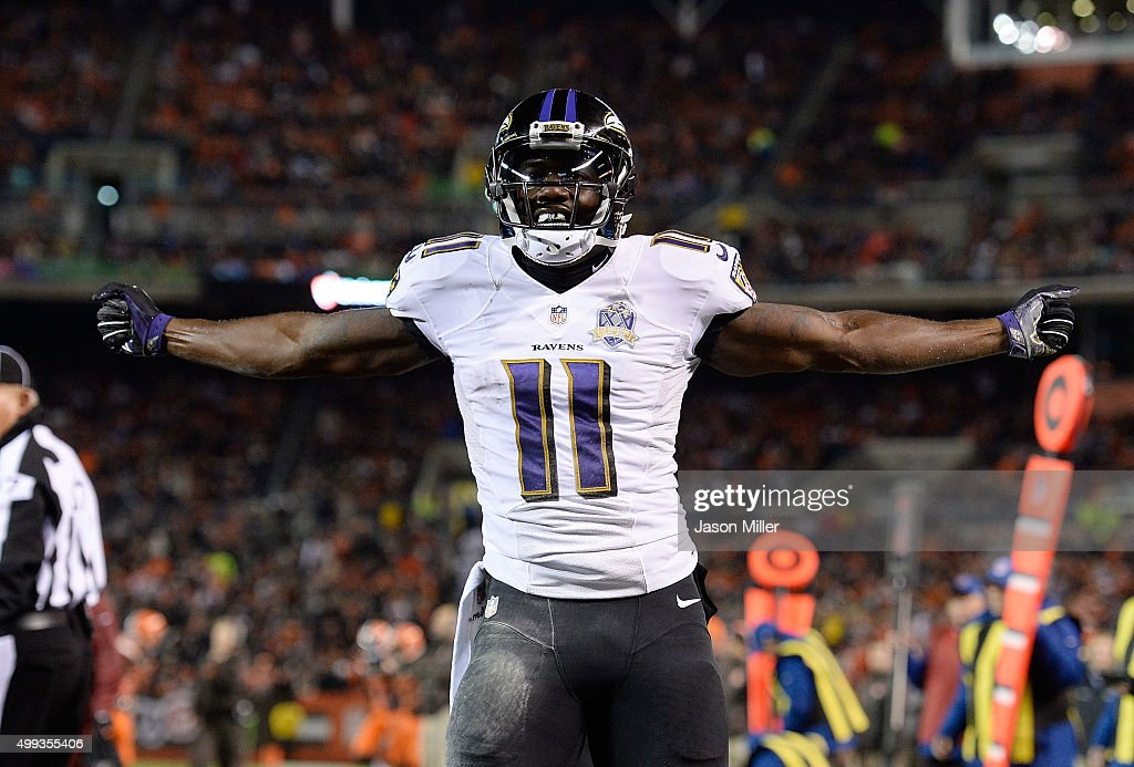 Kamar Aiken #11 of the Baltimore Ravens celebrates his touchdown during the third quarter against the Cleveland Browns at FirstEnergy Stadium on November 30, 2015 in Cleveland, Ohio.