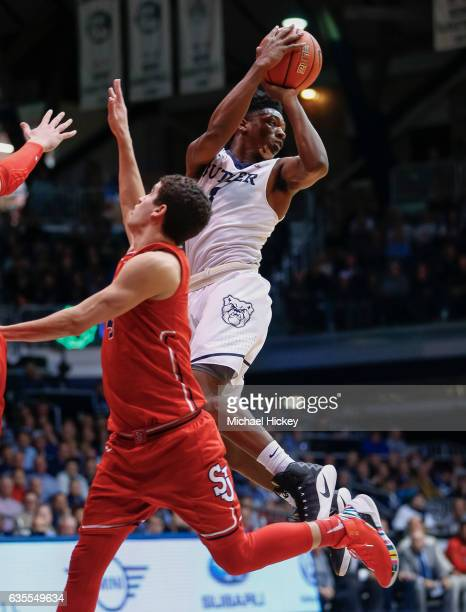 Kamar Baldwin of the Butler Bulldogs passes the ball off as Federico Mussini of the St John's Red Storm defends at Hinkle Fieldhouse on February 15...