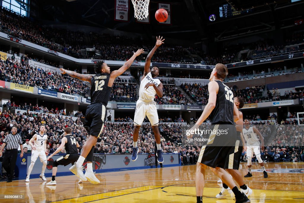 Kamar Baldwin #3 of the Butler Bulldogs shoots against Vincent Edwards #12 of the Purdue Boilermakers in the second half of the Crossroads Classic at Bankers Life Fieldhouse on December 16, 2017 in Indianapolis, Indiana. Purdue won 82-67.