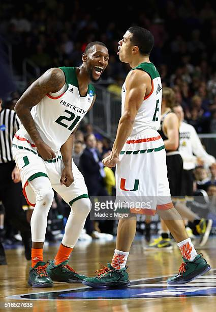Kamari Murphy of the Miami Hurricanes and Angel Rodriguez celebrate defeating the Wichita State Shockers 6557 during the second round of the 2016...