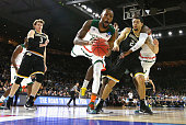 Kamari Murphy of the Miami Hurricanes attempts to handle the ball in the first half against the Wichita State Shockers during the second round of the...