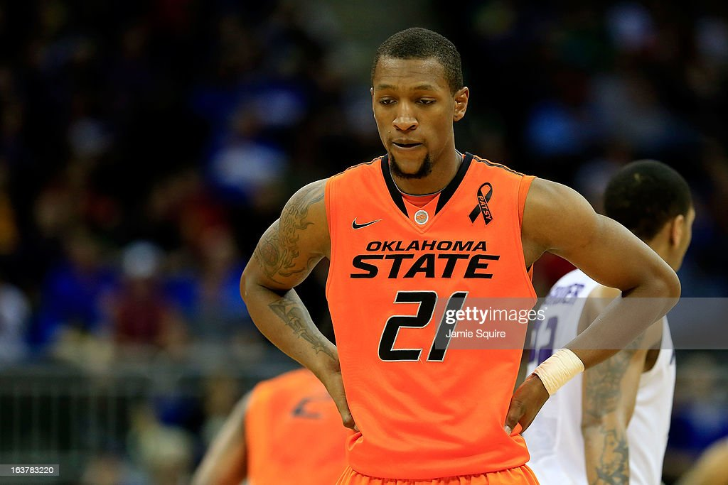 Kamari Murphy #21 of the Oklahoma State Cowboys reacts while playing against the Kansas State Wildcats in the second half during the Semifinals of the Big 12 basketball tournament at the Sprint Center on March 15, 2013 in Kansas City, Missouri.