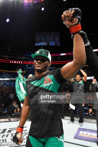 Kamaru Usman of Nigeria celebrates his unanimous decision victory over Sean Strickland in their welterweight bout during the UFC 210 event at KeyBank...