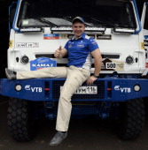 Kamaz's driver Eduard Nikolaev of Russia poses after a technical chekup in Rosario Argentina on January 3 ahead of the 2014 Dakar Rally which this...