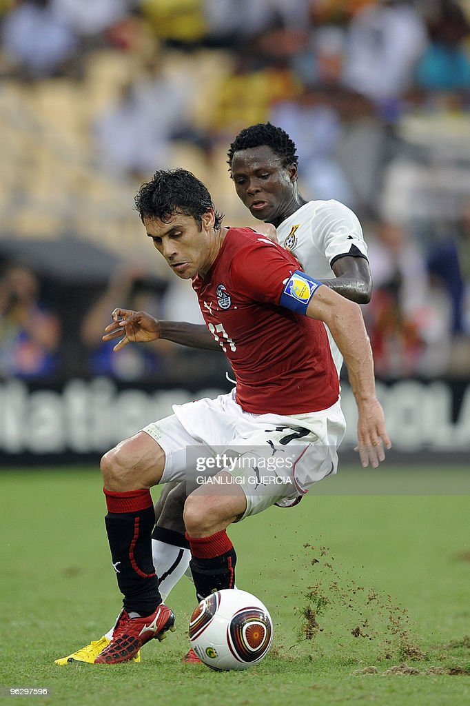Kamel Ahmed Hassan of Egypt prevents Samuel Inkoom of Ghana from breaking trough during their final match of the African Cup of Nations CAN2010 at...