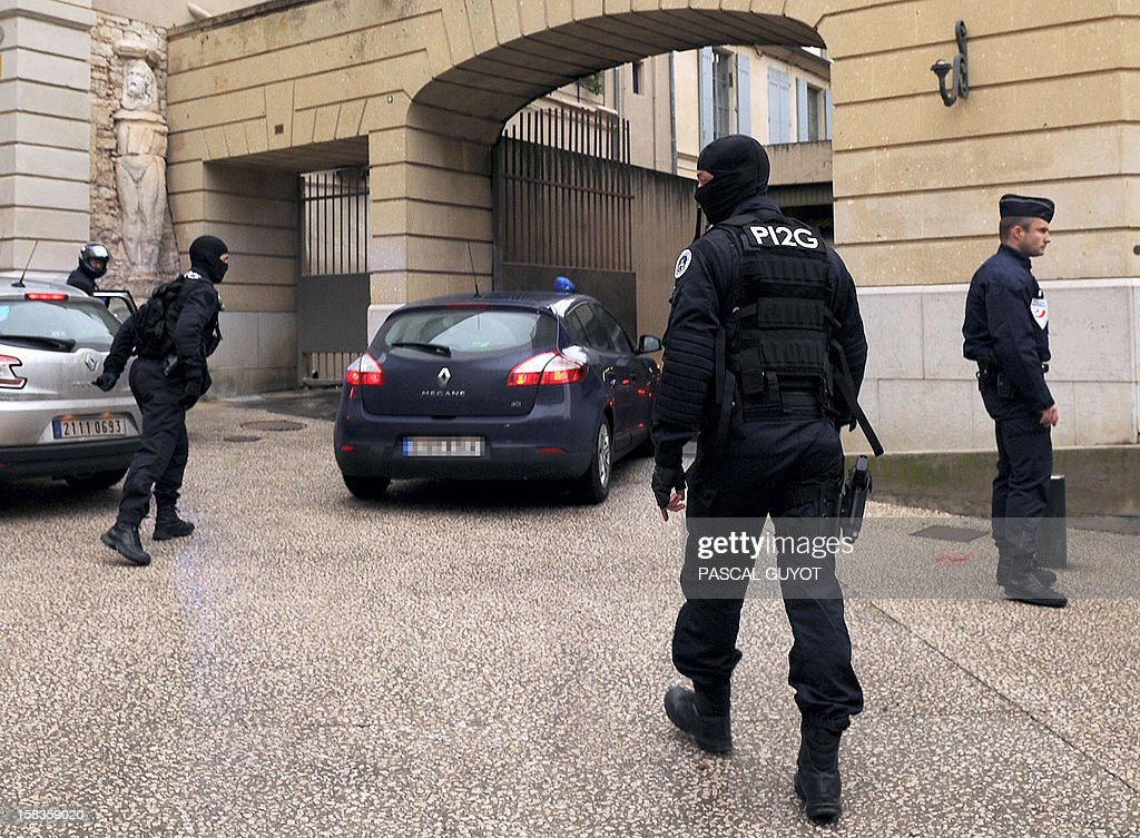 Kamel Bousselat, the presumed abductor of Chloe, a 15-year-old girl who was found alive in Germany after being reported missing for a week, arrives in a police car at the Nimes courthouse for a hearing on December 14, 2012.