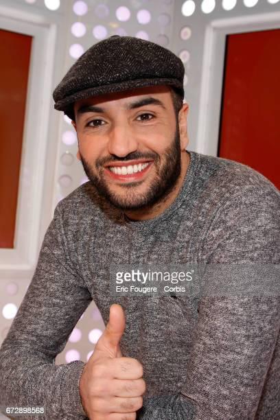 Kamel le magicien poses during a portrait session in Paris France on