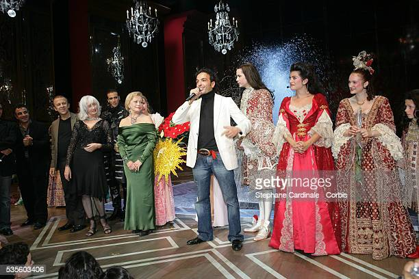 Kamel Ouali with the cast of the musical 'Le Roi Soleil'