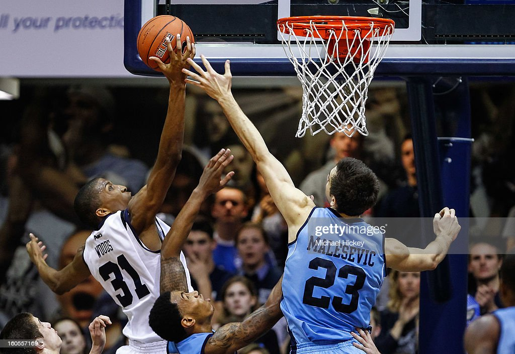 Kameron Woods #31 of the Butler Bulldogs and Nikola Malesevic #23 of the Rhode Island Rams battle for a rebound at Hinkle Fieldhouse on February 2, 2013 in Indianapolis, Indiana. Butler defeated Rhode Island 75-68.