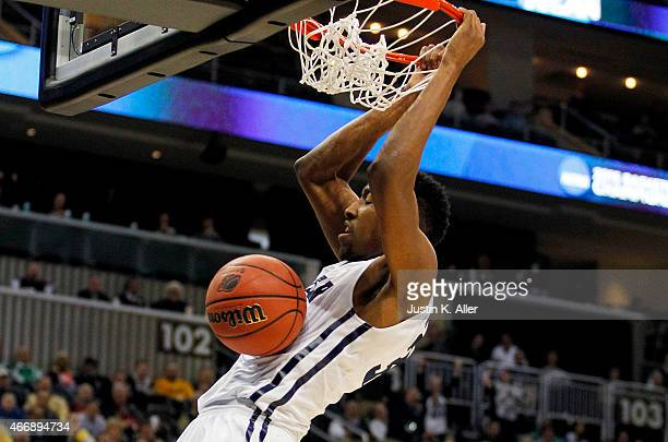 Kameron Woods of the Butler Bulldogs dunks in the first half against the Texas Longhorns during the second round of the 2015 NCAA Men's Basketball...