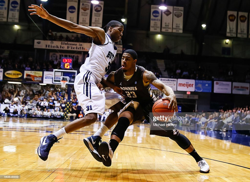 Kameron Woods #31 of the Butler Bulldogs guards as Chris Johnson #23 of the St. Bonaventure Bonnies dribbles to the baseline at Hinkle Fieldhouse on February 6, 2013 in Indianapolis, Indiana. Butler defeated St Bonaventure 77-58.