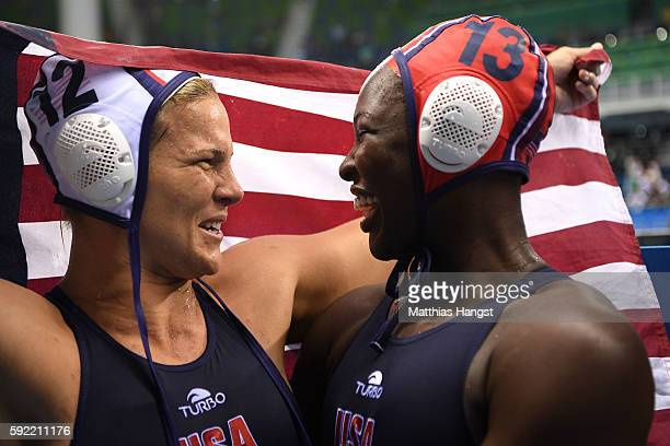 Kami Craig of United States and Ashleigh Johnson of United States celebrate winning the Women's Water Polo Gold Medal match between the United States...