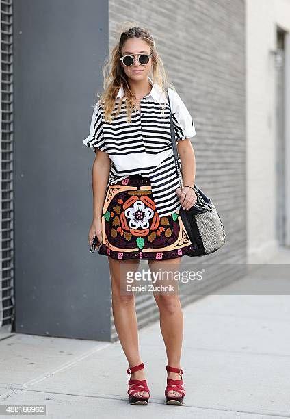 Kami Phillips is seen outside the Tracy Reese show wearing a Derek Lam top and a Pia Pauro skirt and Forever 21 sunglasses during New York Fashion...