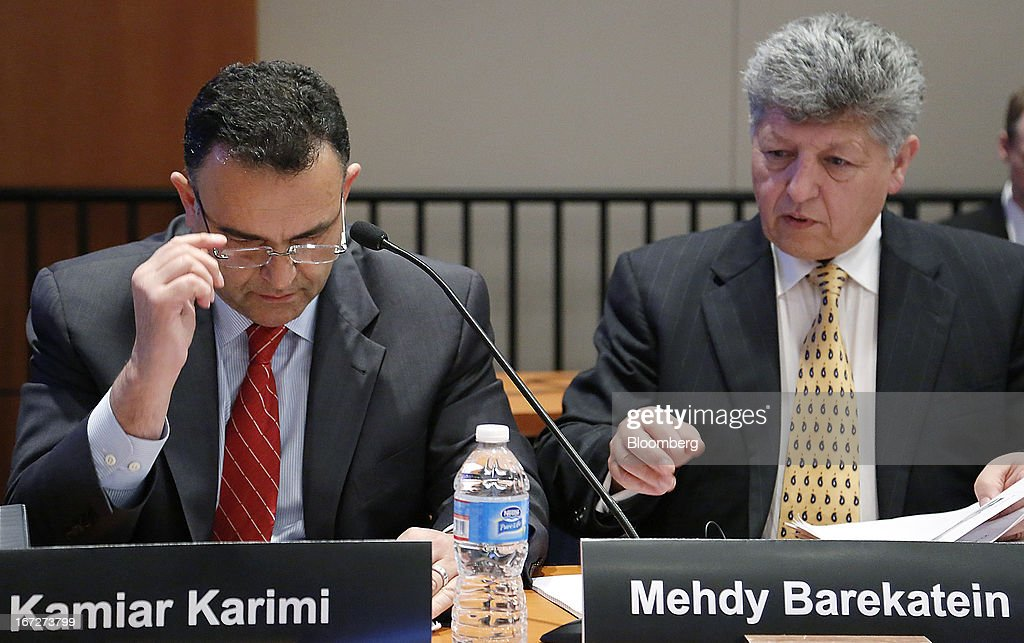 Kamiar Karimi, senior technical fellow in electrical power systems for Boeing Co., left, and Mehdy Barekatein, systems engineer and authorized representative for Boeing Co., testify during a hearing at the National Transportation Safety Board (NTSB) in Washington, D.C., U.S., on Tuesday, April 23, 2013. Boeing Co. has begun repairs on the 787 Dreamliner to fix a battery fault that grounded the fleet for three months as it enters talks with airlines to resume deliveries and meet a full-year production target. Photographer: Jonathan Ernst/Bloomberg via Getty Images