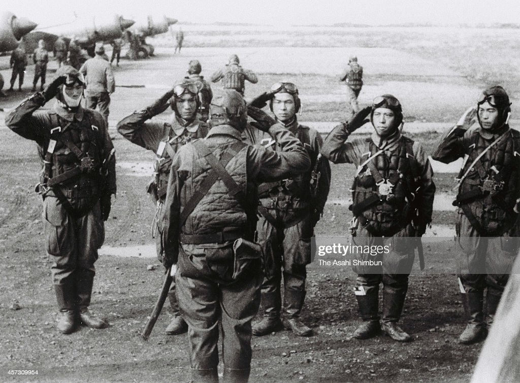 Kamikaze pilots of Sekicho Hikotai of Imperial Japanese Army salute prior to the battle of Leyte Gulf on December 5 1944 in the Philippines