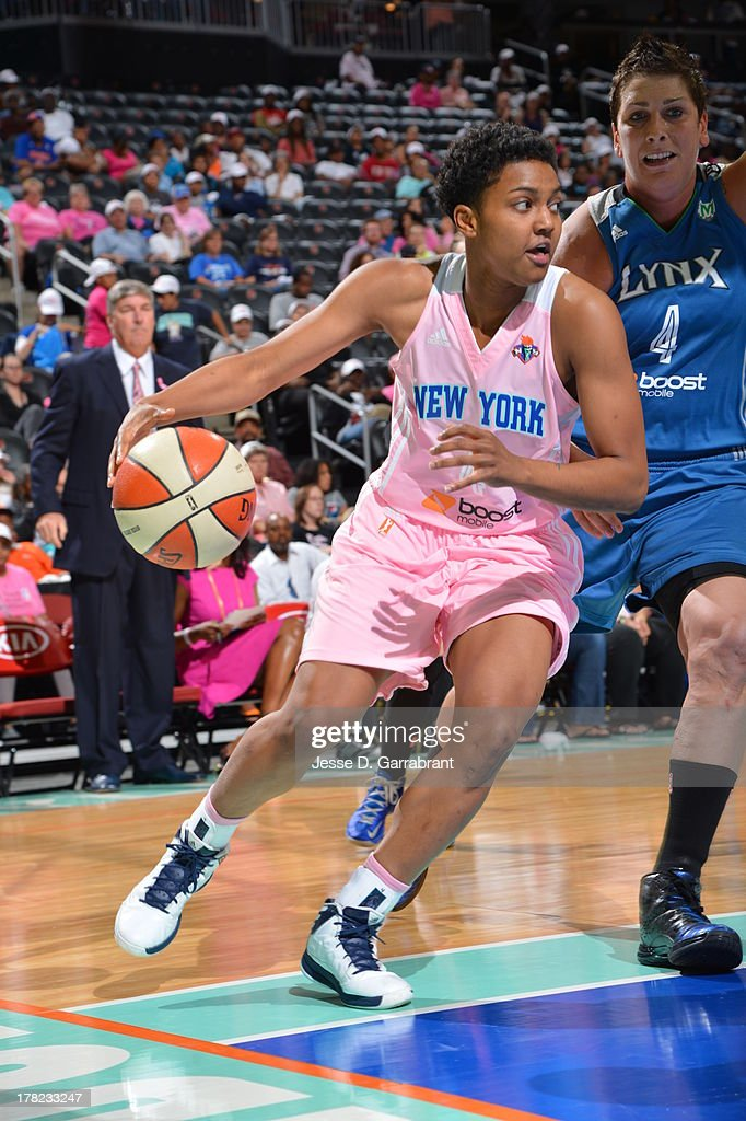 Kamiko Williams #4 of the New York Liberty drives against the Minnesota Lynx during the game on August 27, 2013 at Prudential Center in Newark, New Jersey.